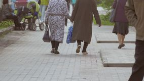 Rear view of two old women go slow motion video. Rear view of two old women leave in ridiculous outfits Russian slow motion video stock video footage