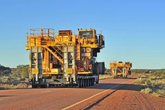 Rear view of two oversize road trains. stock image