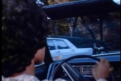 Rear view of two people taking a drive in a convertible stock footage
