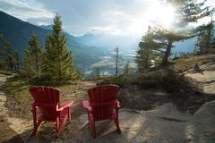 Two chairs overlooking valley stock images