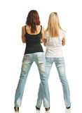 Rear view of two women in jeans Royalty Free Stock Photo