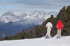 Rear view of two women in Skiing gear Royalty Free Stock Images