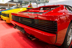 Rear view of various modifications of sports cars Ferrari Testarossa and F512. Stock Images