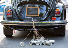 Rear view of a vintage car with just married sign and cans attached stock photos