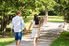Rear view of walking couple in park Stock Photo