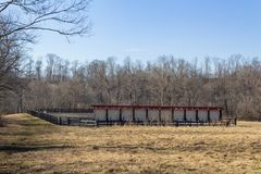 Rear view of wall of mirrors at an outdoor dressage ring, winter royalty free stock photography