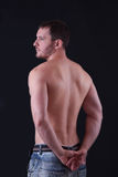 Rear view of a well-built young man Stock Photography