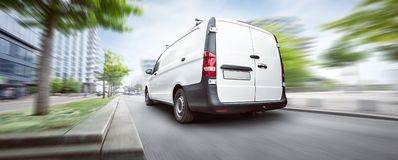 Commercial van driving in the city stock images