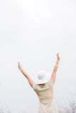 Rear View of Woman With Arms Raised Stock Image