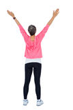 Rear view of woman with arms raised Stock Photo