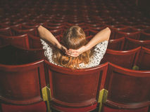 Rear view of woman in auditorium Royalty Free Stock Image