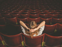 Rear view of woman in auditorium Stock Photo