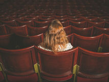 Rear view of woman in auditorium Stock Image