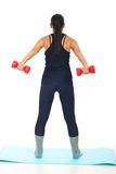 Rear view of woman with barbell Stock Photos