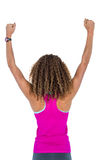 Rear view of woman cheering with arms raised Royalty Free Stock Photography