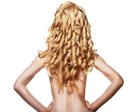 Rear view of woman with curly long blond hair. Well-being & spa. Sensual woman model with shiny curly long blond hair isolated over white. Health, beauty Stock Photos