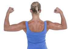 Rear view of woman flexing muscles. Against white background Stock Images