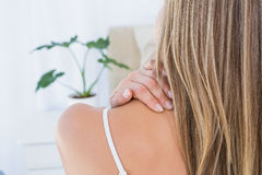 Rear view of woman getting neck pain Royalty Free Stock Photography