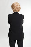 Rear view of a woman hand crossed Stock Image