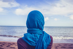 Rear view of woman with headscarf looking at the sea Royalty Free Stock Photo