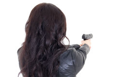 Rear view of woman holding gun isolated on white Royalty Free Stock Images