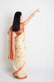 Rear view woman in Indian sari dress pointing Stock Photo