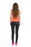 Rear View Of Woman In Leather Trousers Royalty Free Stock Photography