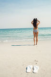 Rear view of woman looking at the ocean Royalty Free Stock Photos