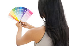 Rear view of a woman looking at paint samples Stock Images
