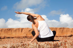 Rear view of woman making yoga stock images