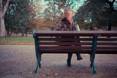 Rear view of woman on park bench Royalty Free Stock Photography