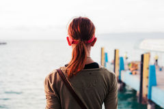 Rear view of woman by pier Stock Photo