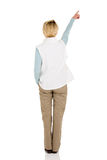 Rear view woman pointing Royalty Free Stock Photo