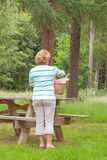 Rear view of a Woman preparing a picnic Stock Image