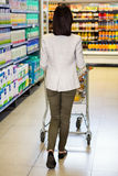 Rear view of woman pushing trolley Royalty Free Stock Photo