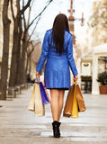 Rear view of woman   with shopping bags Royalty Free Stock Photography