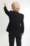 Rear view of a  woman signaling something Royalty Free Stock Photos