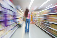 Rear view of woman standing in aisle with blurred effects Stock Images