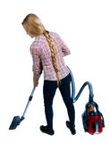 Rear view of a woman with a vacuum cleaner. Stock Photo