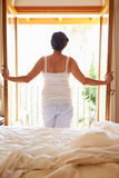 Rear View Of Woman Waking Up In Bed In Morning Royalty Free Stock Photos