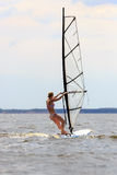Rear view of woman windsurfing Royalty Free Stock Photo