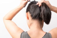 Rear view of women tightening the hair, lifestyle concept. Rear view of woman tightening the hair, lifestyle concept Royalty Free Stock Photography