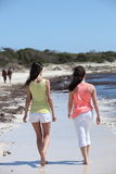 Rear View of Women Walking at the Beach Stock Photos