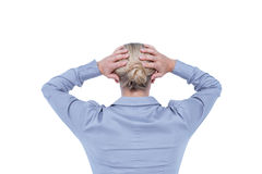 Rear view of worried businesswoman holding her head Stock Images