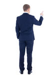 Rear view of young business man pointing at something isolated o Royalty Free Stock Image