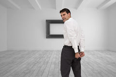 Rear view of young businessman wearing handcuffs Stock Photography