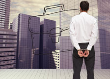 Rear view of young businessman wearing handcuffs Royalty Free Stock Image