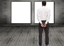 Rear view of young businessman wearing handcuffs Royalty Free Stock Images