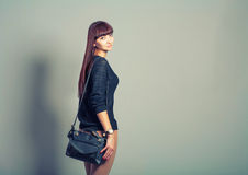 Rear view of young casual woman in pants look back Royalty Free Stock Photography