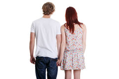 Rear view of a young couple holding their hands. Stock Photos